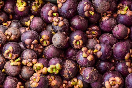 Fresh Mangosteens in a Local Market