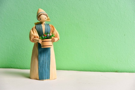 Isolated Corn Husk Doll on Green Background