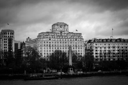 Photo of Shell Mex Building Across River Thames on a cloudy day with Black and White Effect