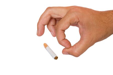 Cigarette and hand on a white background photo