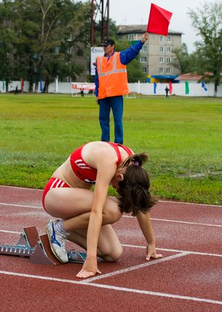 CHERNOGORSK, RUSSIA - JULY 4: Chernogorsk, athletics. Girl on the starting line. July 4, 2010 in Chernogorsk, Russia. Stock Photo - 7289305