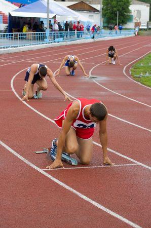 CHERNOGORSK, RUSSIA - JULY 4: Chernogorsk, athletics. Men on the starting line. July 4, 2010 in Chernogorsk, Russia. Stock Photo - 7289306