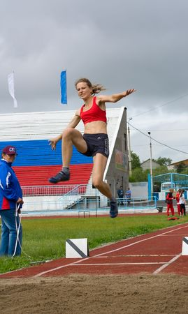 CHERNOGORSK, RUSSIA - JULY 4: Chernogorsk, athletics. Games of the people of Republic Khakassia. Long jumps - women. Sherbak Lubov long jumps. July 4, 2010 in Chernogorsk, Russia. Stock Photo - 7374365