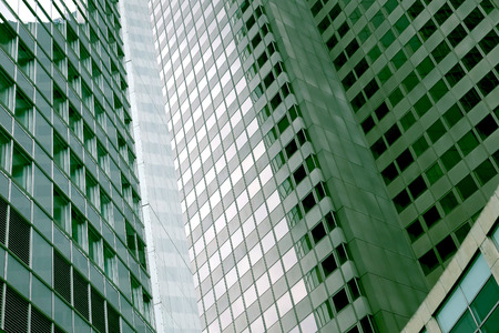 green tone: Modern tall buildings with green tone. Background