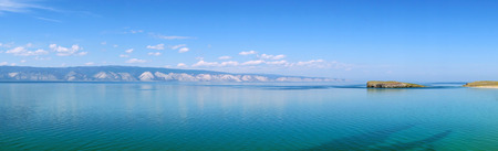 Delicate blue tone of Lake Baikal in calm weather. Beautiful summer morning. Siberia, Russia.