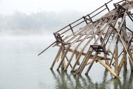 broken bridge in the river on morning