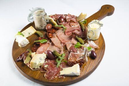 Various foods in charcuterie board Stock Photo