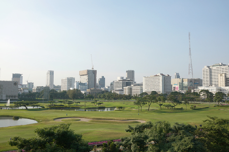 Golf course in the city with building in background Stock fotó