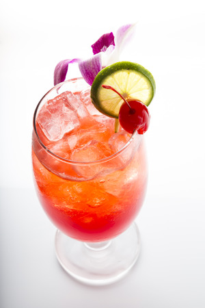 Cocktail decorate with lime cherry and orchid Stock fotó