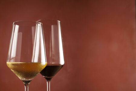 Red wine and White wine in glass on left side of frame