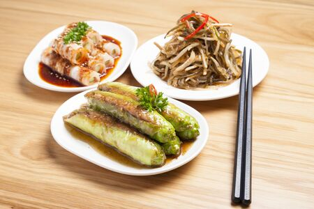 Various type of Chinese foods and chopsticks on table Фото со стока