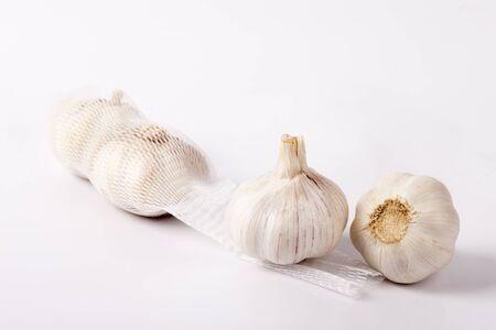Garlics in bag and garlics outside bag ontable Stock fotó