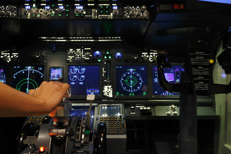 Hand control in cockpit of flight simulator