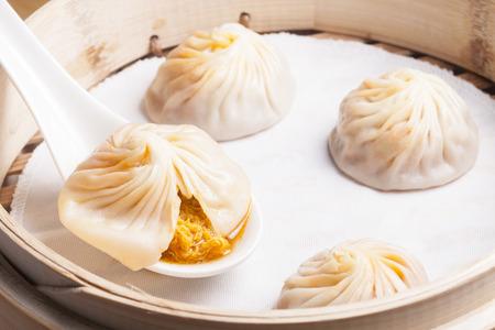 Xiao Long Bao in spoon show its stuff in side