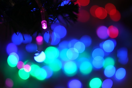 Light on christmas tree with various colour of bokeh in blackground