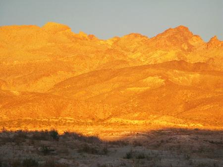 transforms: Evening sun transforms the Nevada mountains into a Golden color