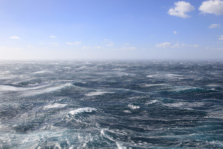 at sea: Very stormy seas and Blue Skies