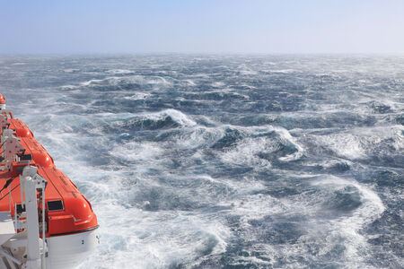 Lifeboats very rough seas and sunshine photo