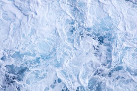 spume: Stormy weather whips up the spray foam and spume of the ocean Stock Photo