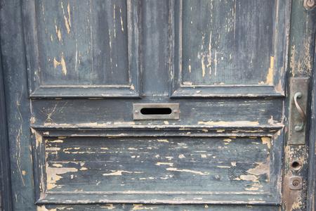 unkept: Old peeling wooden door