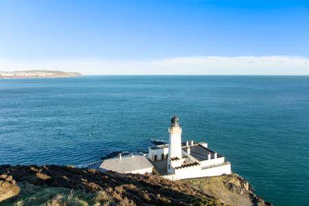 british isles: Irish Sea Douglas Bay and lighthouse Isle of Man British Isles Stock Photo