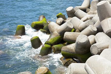 interlocking: Massive concrete interlocking tetrapods making up a sea wall defense Stock Photo