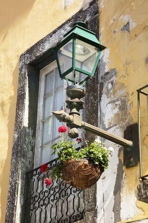 hanging basket: Old European street lamp and hanging basket with flowers
