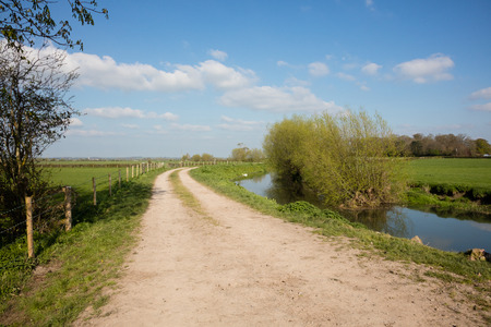 River and towpath winding through farmland in Somerset England