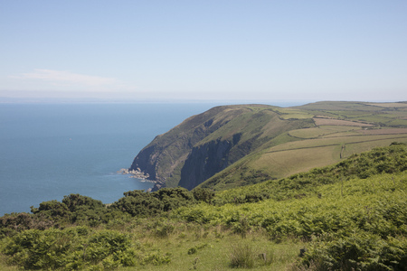 Beautiful rugged coast of North Devon England with Wales on the horizon