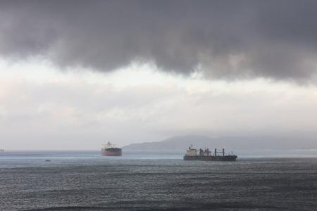 Stromy clouds over ships anchored in the Gibraltar harbour Reklamní fotografie