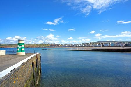 Lighthouse and docks Peel Isle of Man Stock Photo