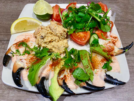 Luxury fresh seafood salad of crab claws, mixed crab meat, avocado and green salad