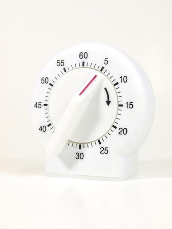 Kitchen timer on white background photo