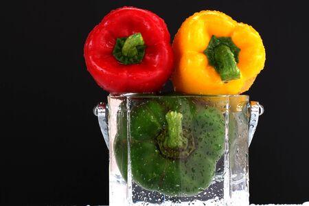 three fresh sweet pepper in water Stock Photo - 13953801