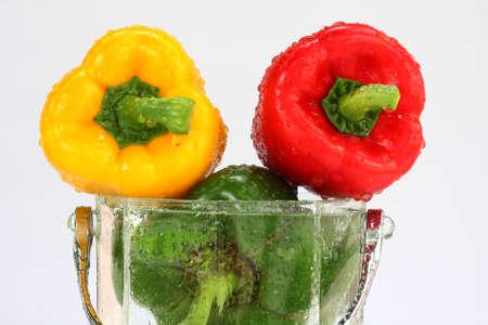 three fresh sweet pepper in water photo