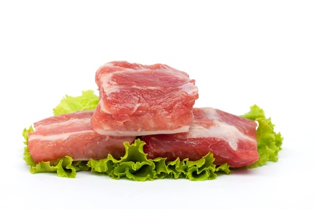 Raw pork ribs and vegetables Stock Photo
