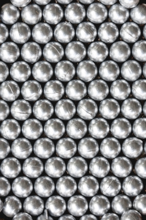 compounding: raw plastic material gray granules back ground