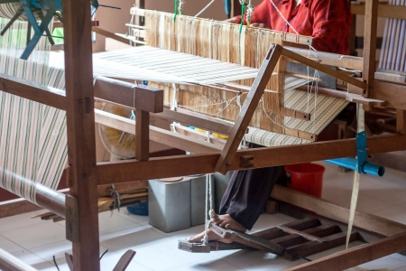 hand crank: Woman working at the loom silk of thailand Stock Photo