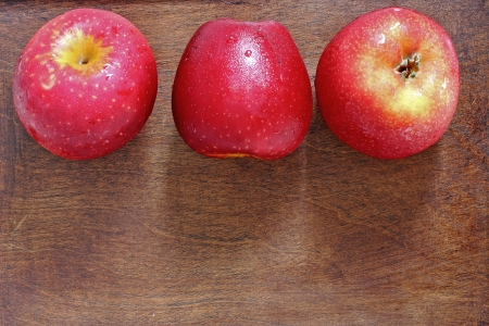 Three apples on the wood Stock Photo - 20819254