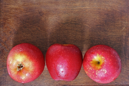 Three apples on the wood Stock Photo - 20819255