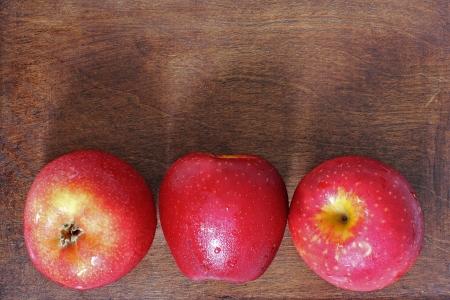 Three apples on the wood Stock Photo - 20819255