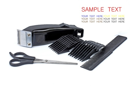 hair clipper, comb and scissors on white background photo