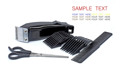hair clipper, comb and scissors on white background
