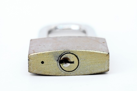 close up shot of old lock isolated on a white background photo