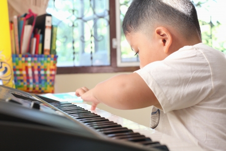 Little Boy playing piano fun photo