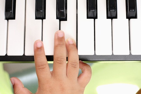 Hand of the boy  Playing the piano photo