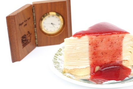 Strawberry cake on a white and clock background  photo