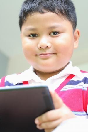 Tablet boy playing fun  photo