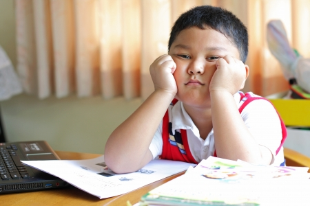 The boy tired of homework  Stock Photo