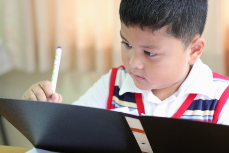 The boy intently to checking documents photo